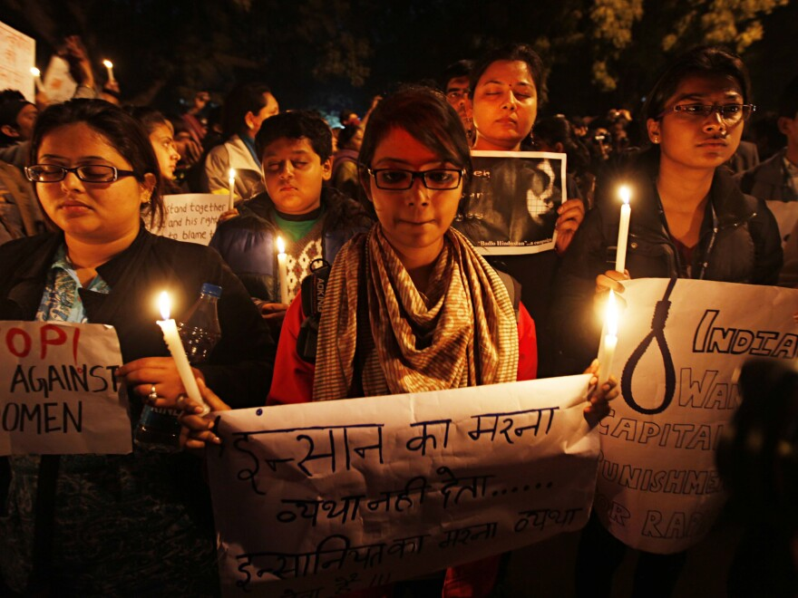 A candlelight vigil in 2013 marks the one-year anniversary of the death of a 23-year-old woman who was gang-raped on a bus in Delhi.