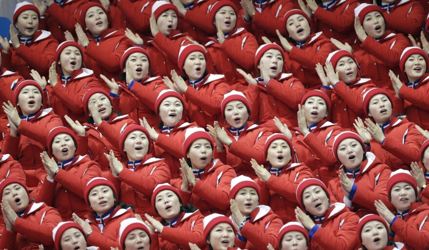 North Korean supporters sing ahead of the pairs free skate final in the Gangneung Ice Arena.