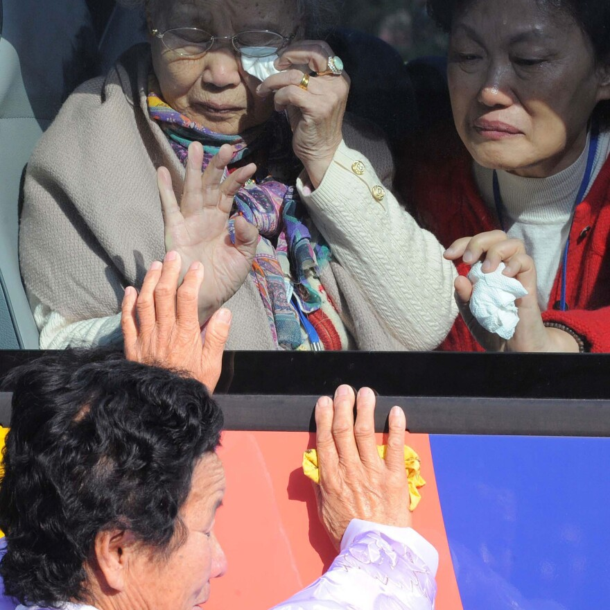 South Koreans bid farewell to their North Korean relatives before returning home on a bus after family reunions in 2010.