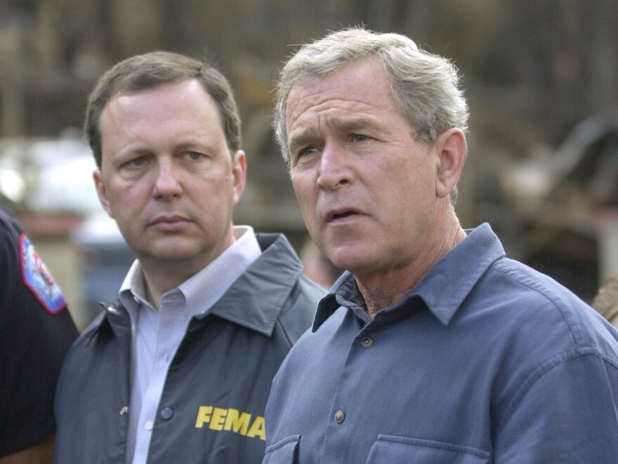 FEMA's Michael Brown (left) and President George W. Bush, seen in 2003, were widely criticized for their response after Hurricane Katrina devastated the Gulf Coast in 2005.