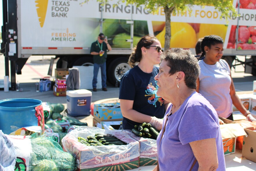 Diane Fike selects food items at the Austin VA's food pantry site. It's part of a collaboration between the VA and Feeding America.