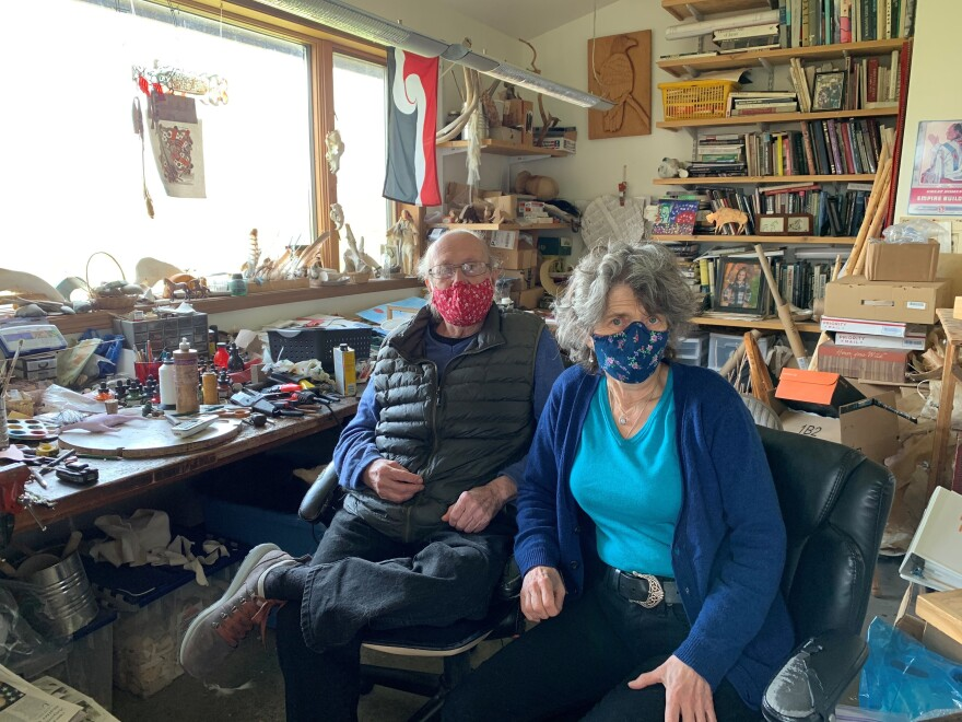 Lodgepole Art Gallery and Tipi Village owners Darrel Norman (left) and Angelika Harden-Norman in their home art studio. The Normans aren't rushing to get back to business. So far there have been no confirmed cases of COVID-19 on the reservation and they don't want to bring in the first case.