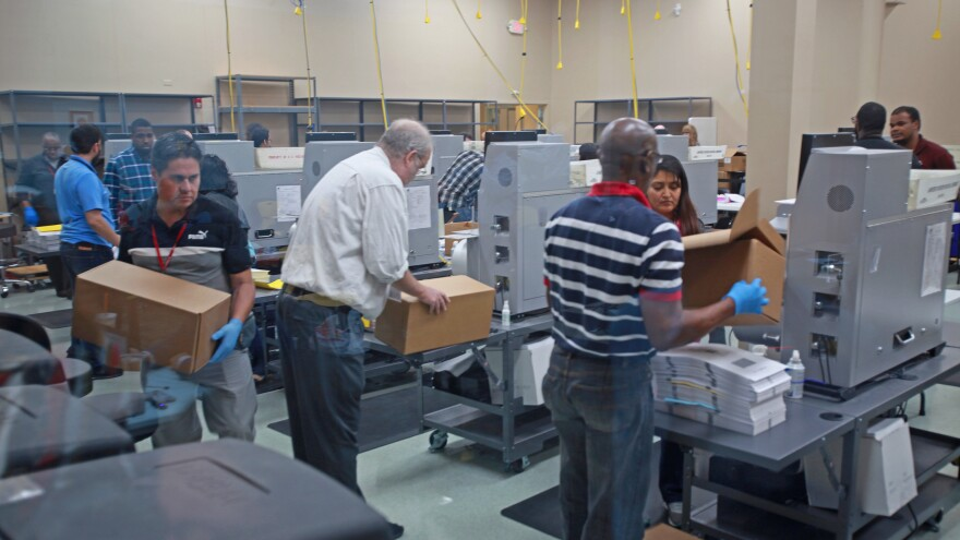 Election workers recount votes for several outstanding Florida races on Tuesday at the office of the Broward County supervisor of elections.