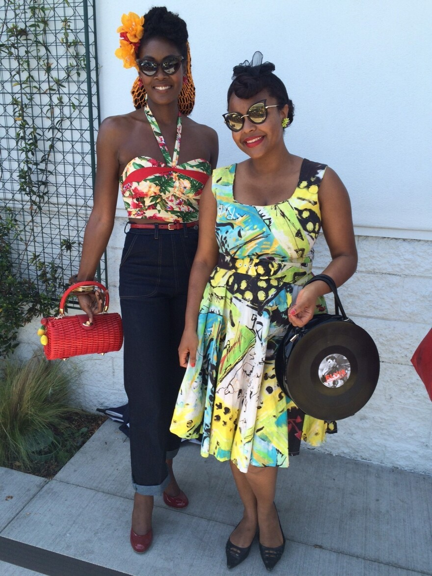 """For some shoppers, like Angelique Noire (left) and Jenny Rieu, """"ethical fashion"""" means lining up for a vintage clothing sale."""