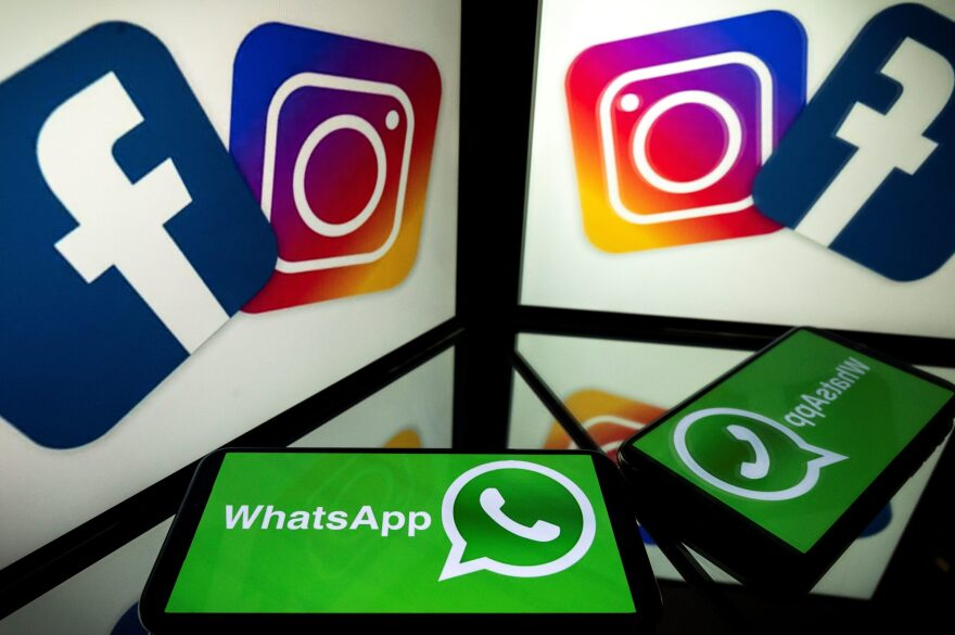 Logos of US social networks Facebook, Instagram and mobile messaging service WhatsApp on the screens of a smartphone and a tablet. (Lionel Bonaventure/AFP via Getty Images)