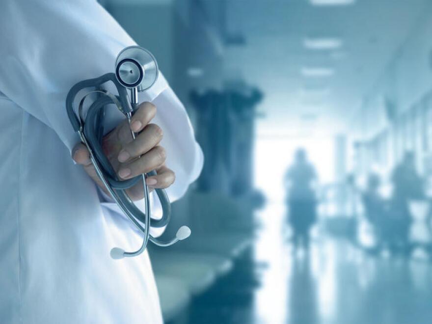 Man holding stethoscope