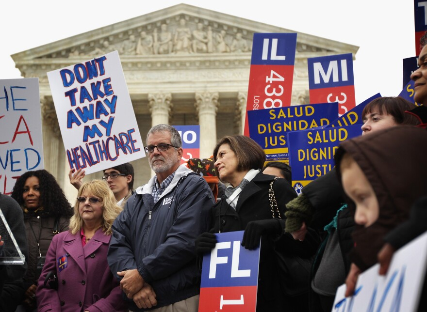 Supporters of the Affordable Care Act rally in front of the U.S. Supreme Court in Washington, D.C., on March 4. The Supreme Court is considering the case of <em>King v. Burwell, </em>which could determine the fate of health care subsidies for millions of people.