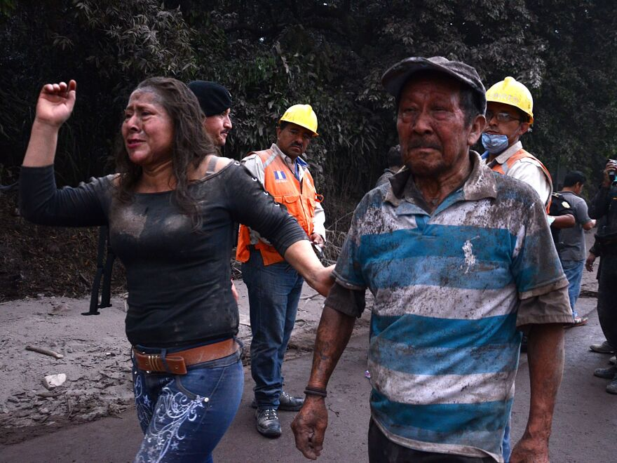 People flee El Rodeo village, less than 30 miles from the capital, Guatemala City, after the eruption of the Fuego volcano on Sunday.