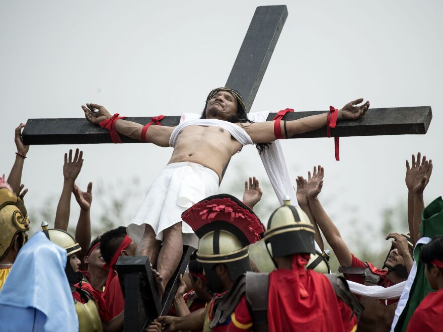 Ruben Enaje, a Christian in the Philippines, participates in a reenactment of the crucifixion of Jesus Christ during Good Friday celebrations in the village of Cutud.