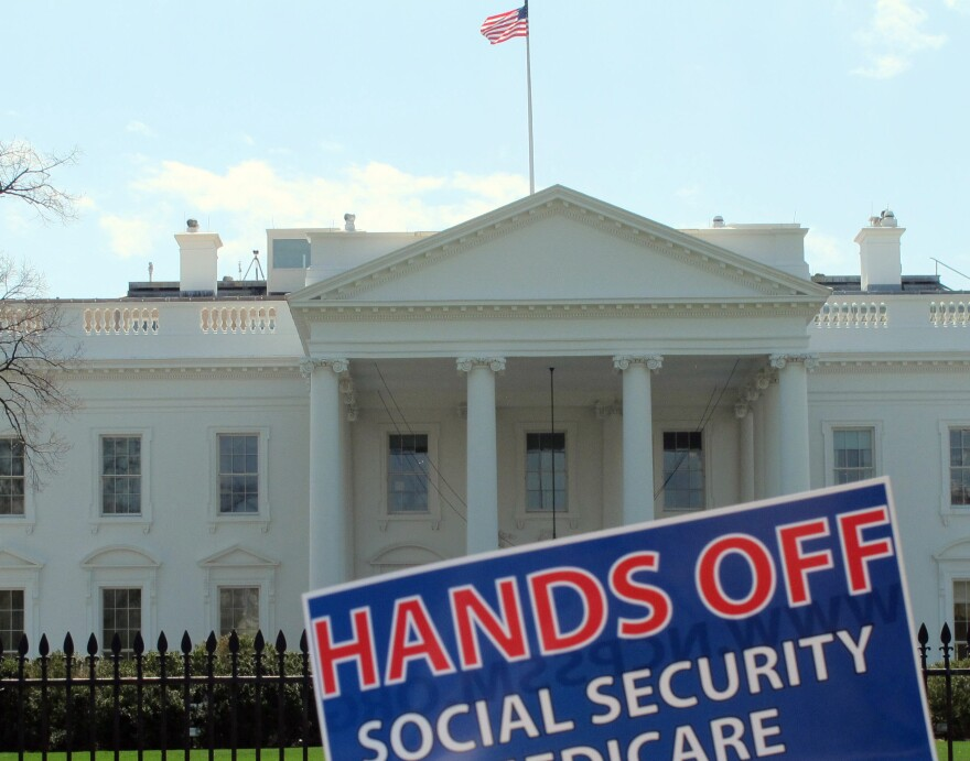 A sign outside the White House on Tuesday protests part of President Obama's proposed federal budget.