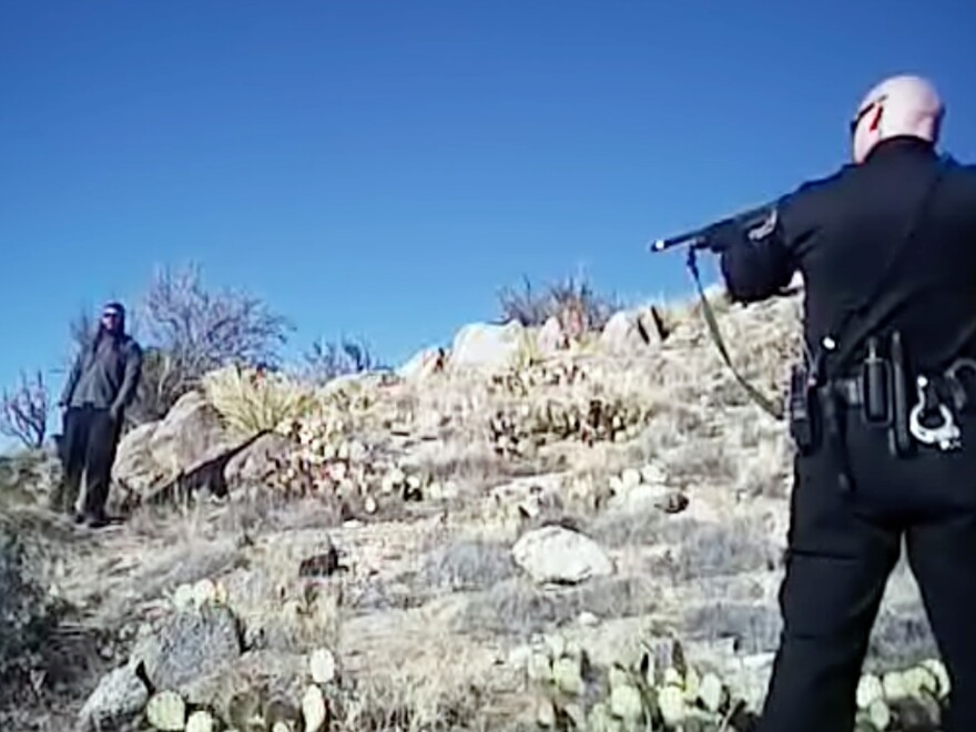 An image from a March 2014 video shows 38-year-old James Boyd (left) before he was fatally shot during a standoff with Albuquerque police officers.