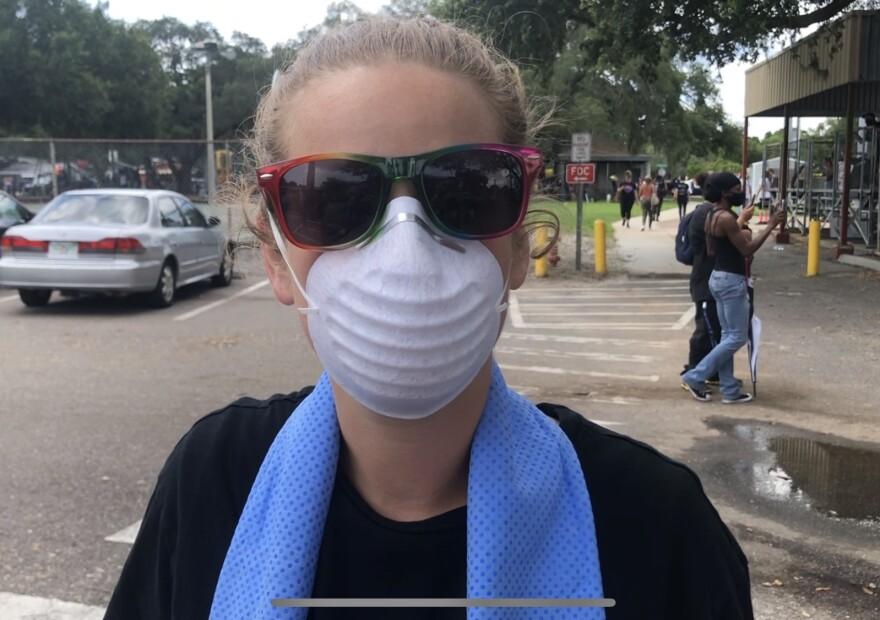 A woman wearing an n95 mask.