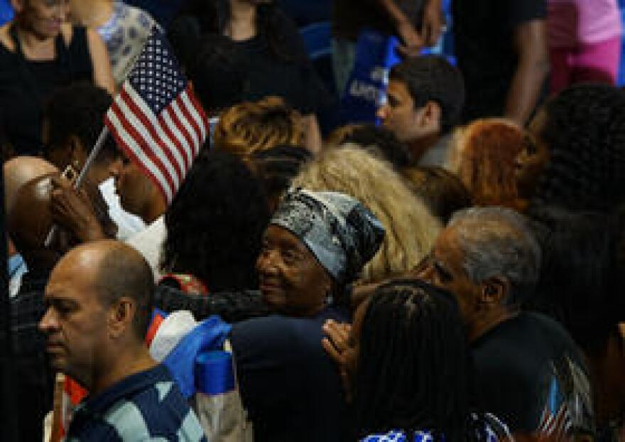 Participants of the rally cheered and sang while waiting for the arrival of president Obama.