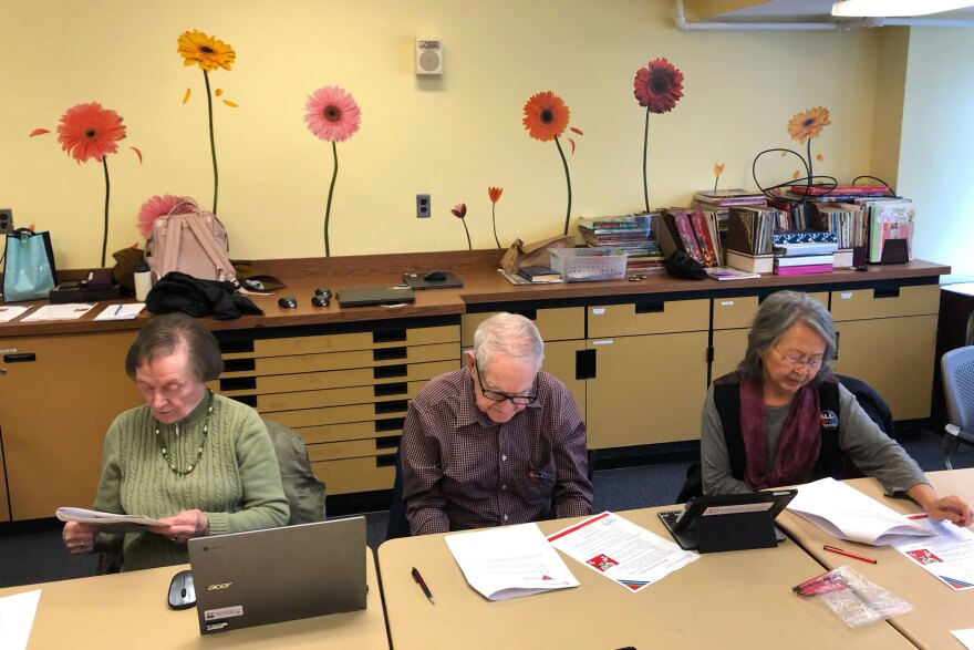 Seniors at the Schweinhaut Senior Center participate in a workshop on spotting fake news. The workshop is organized by the nonprofit Senior Planet.