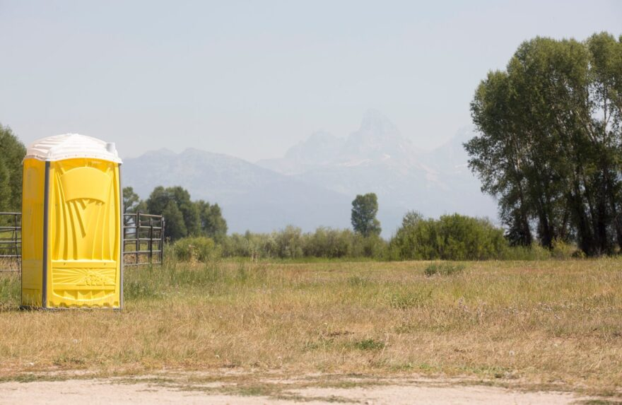 A porta-potty waits for eclipse campers at the rodeo grounds in Tetonia, Idaho. On Sunday afternoon, two tents were seen at the makeshift campground.