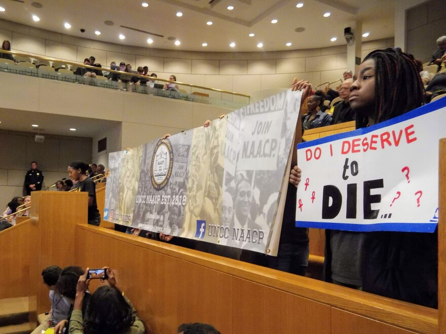 A group of students with UNC Charlotte's NAACP chapter urged the city council Monday to take action on police killings of black men.