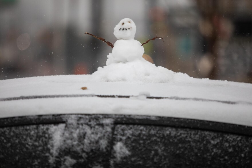 Snow fell in Austin on Sunday, spurring some individuals to build snowmen.