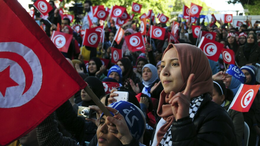 Tunisians celebrate the fifth anniversary of the Arab Spring on Thursday in Tunis.