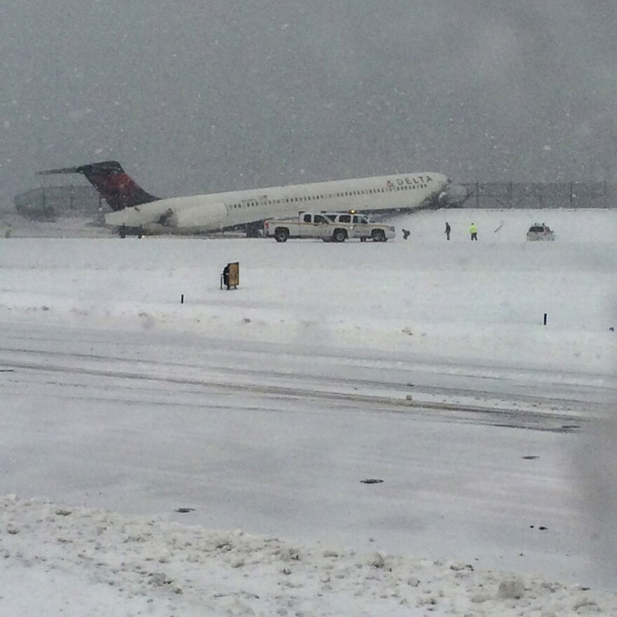 A Delta jet which skidded off the runway at LaGuardia airport is attended by emergency personnel in New York City, on Thursday.