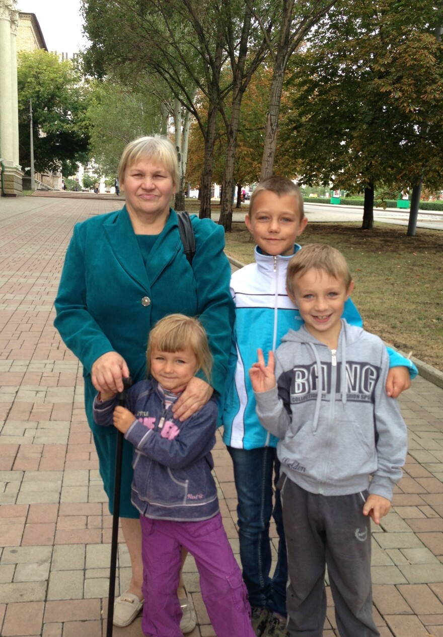 Ludmila Timofeyvna and her grandchildren, taking advantage of the cease-fire between separatists and the Ukrainian government, are once again going outdoors in Donetsk.