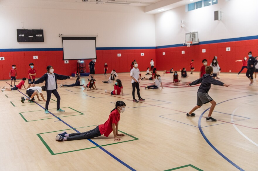 Students strike poses — while keeping a social distance — during a PE class at Hong Kong International School.