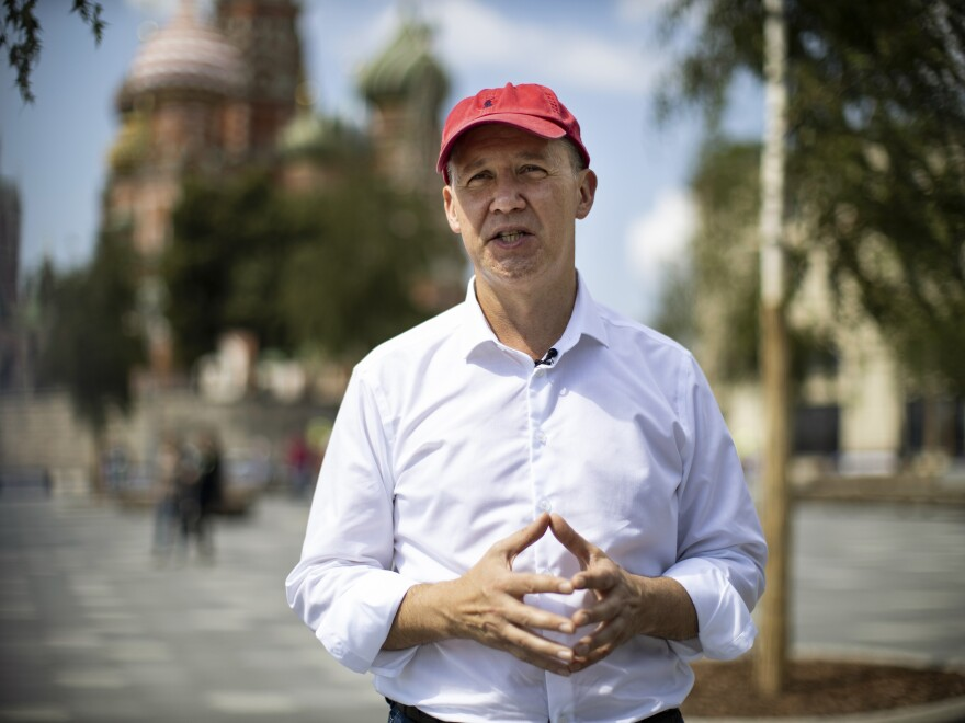 Valery Tsepkalo, an opposition politician from Belarus and former ambassador to the United States, speaks during an interview with the Associated Press near Red Square in Moscow, on July 28, with St. Basil's Cathedral in the background.