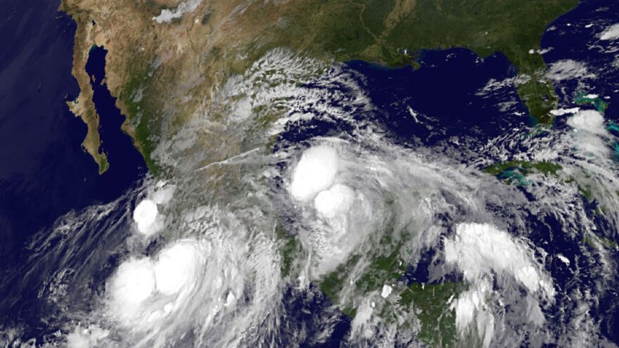 An image provided by NOAA taken at 2:45 a.m. EDT Sunday shows Hurricane Ingrid approaching from the Gulf of Mexico and Tropical Storm Manuel just off the western coast of Mexico.