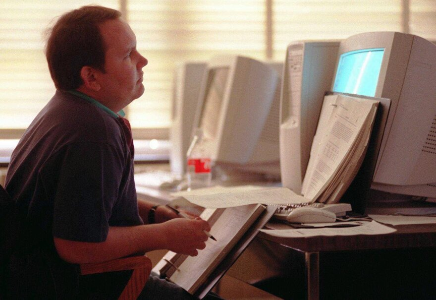 A coding student takes a course on the computer programming language COBOL in 1997 ahead of the Y2K computer meltdown. The coronavirus pandemic has created a dearth of programmers who know how to operate in the pre-Internet coding language.