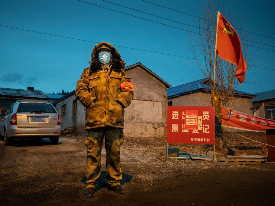 A staff member keeping watch at a checkpoint in Suifenhe, a city on the border with Russia in China's northeastern Heilongjiang province, on Tuesday.