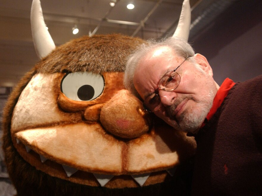 """Maurice Sendak stands with a character from his book """"Where the Wild Things Are,"""" in 2002."""