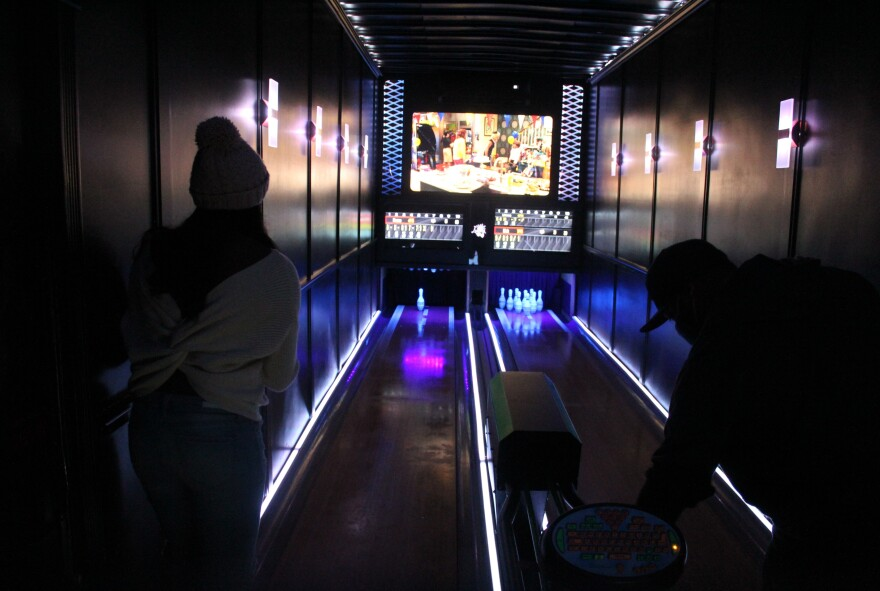 Guests bowl inside Luxury Strike, a mobile bowling alley in metro Detroit.