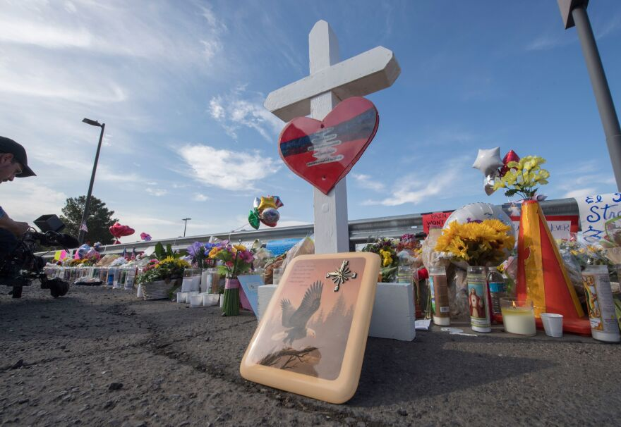 Flowers and signs make up a makeshift memorial on Monday at the Cielo Vista Mall Walmart in El Paso, Texas.