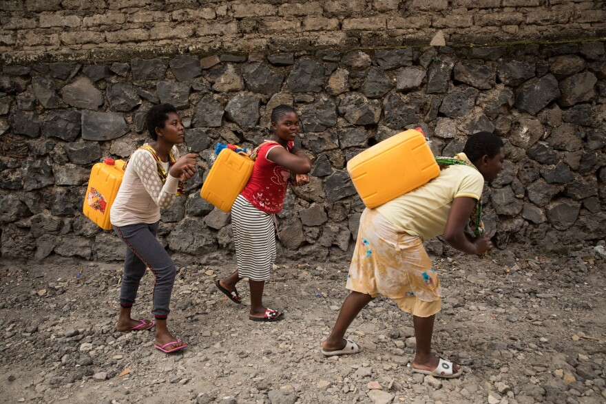 Residents of Goma trek to Lake Kivu for water. The water is not treated so drinking it carries health risks.