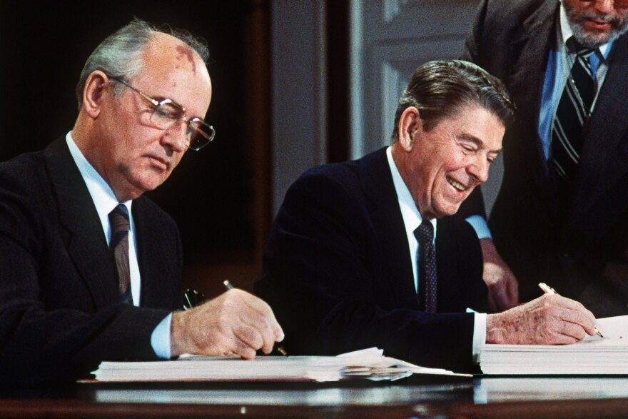 President Ronald Reagan, right, and Soviet leader Mikhail Gorbachev sign the Intermediate-Range Nuclear Forces Treaty in the White House East Room on December 8, 1987.