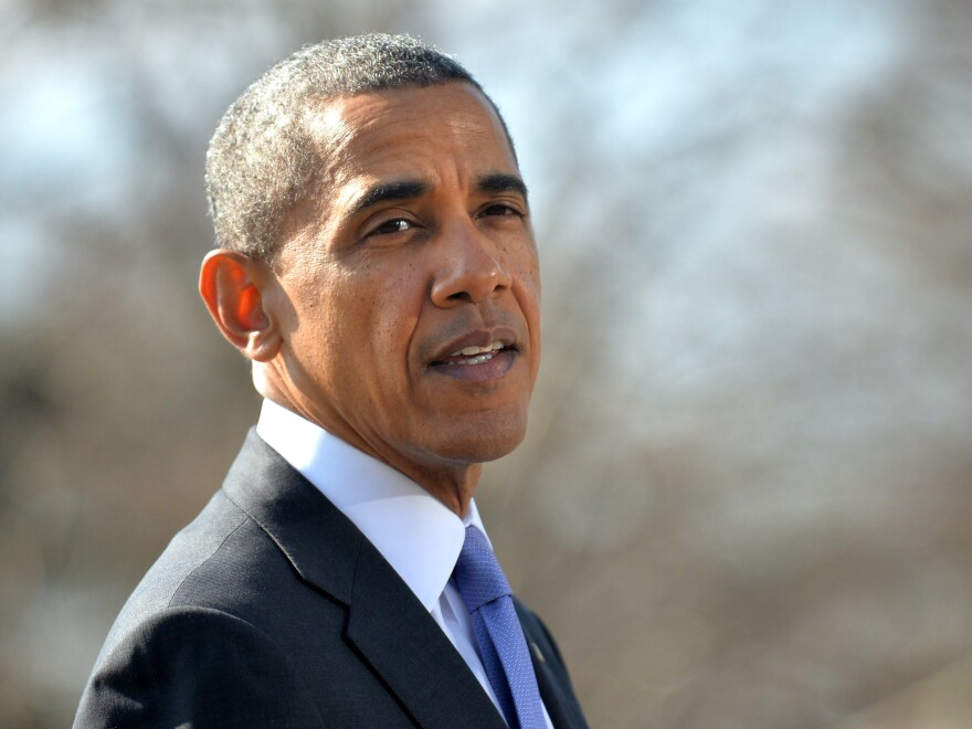 President Obama on the south lawn of the White House Thursday as he spoke about new sanctions on some Russian officials.