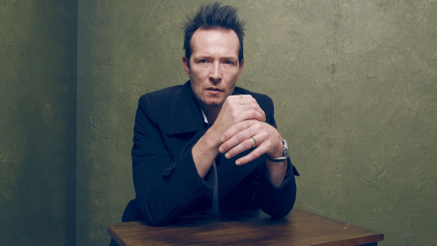 Rock musician Scott Weiland, seen here during a photo shoot at the Sundance Film Festival in January, has died while on tour in Minnesota.
