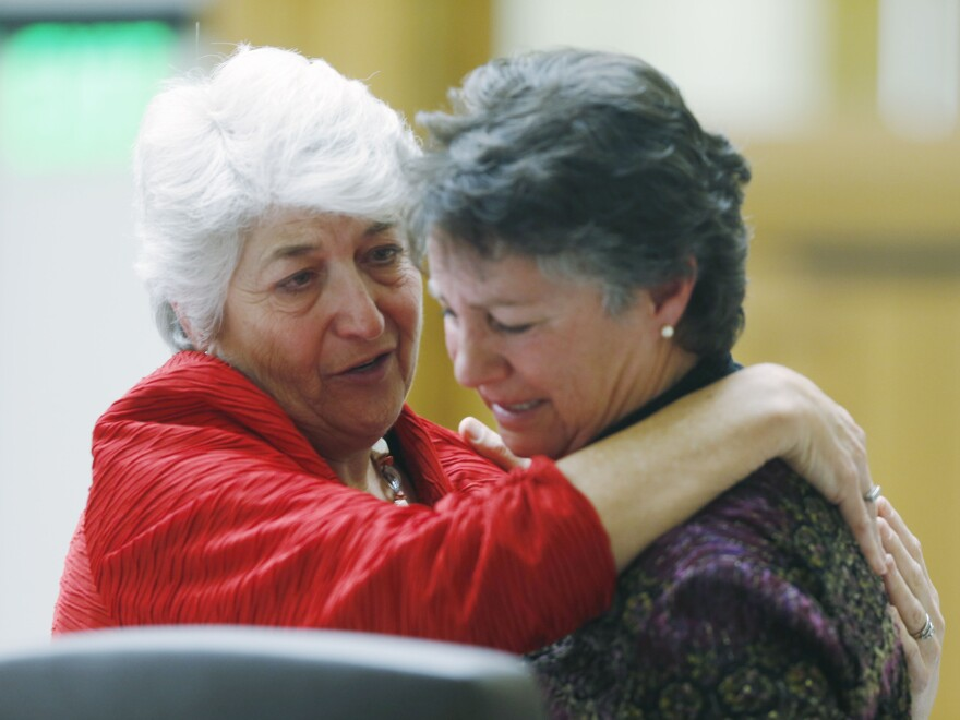 Colorado state Rep. Lois Court consoles Carol Stork after her 2015 testimony about the death of her terminally ill husband, during a legislative hearing on a proposal to offer life-ending medication to such patients.