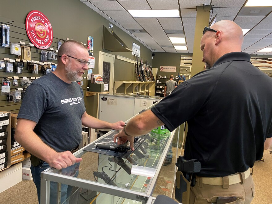"""Most of it is is new gun owners,"" says Michael Weeks (left), a gun store owner in Gainesville, Ga. By one estimate, Americans have bought nearly 3 million more guns than usual since March."