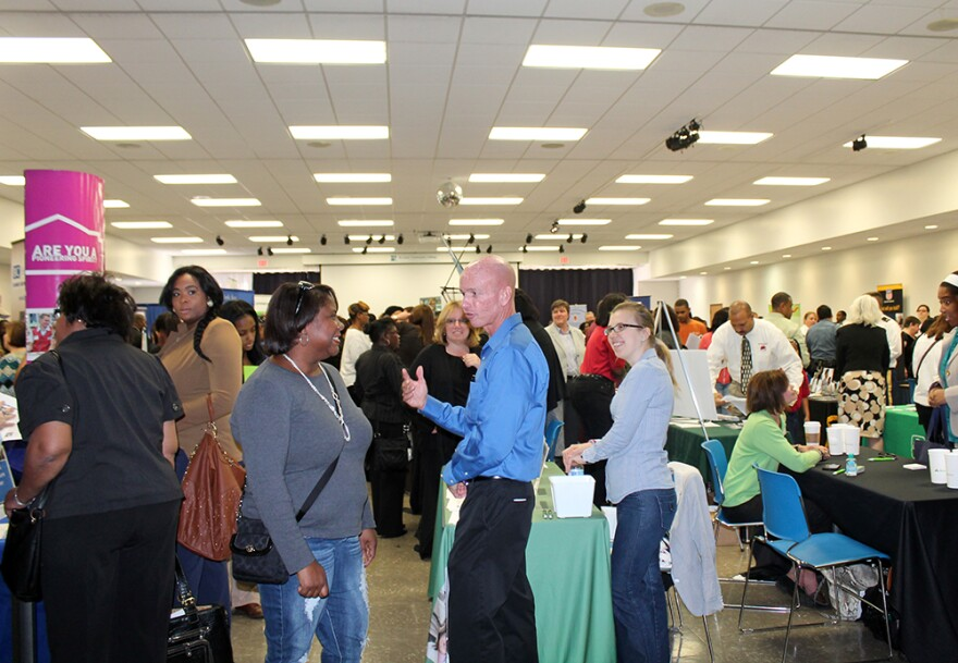 Job seekers attend a job held on Sept. 13