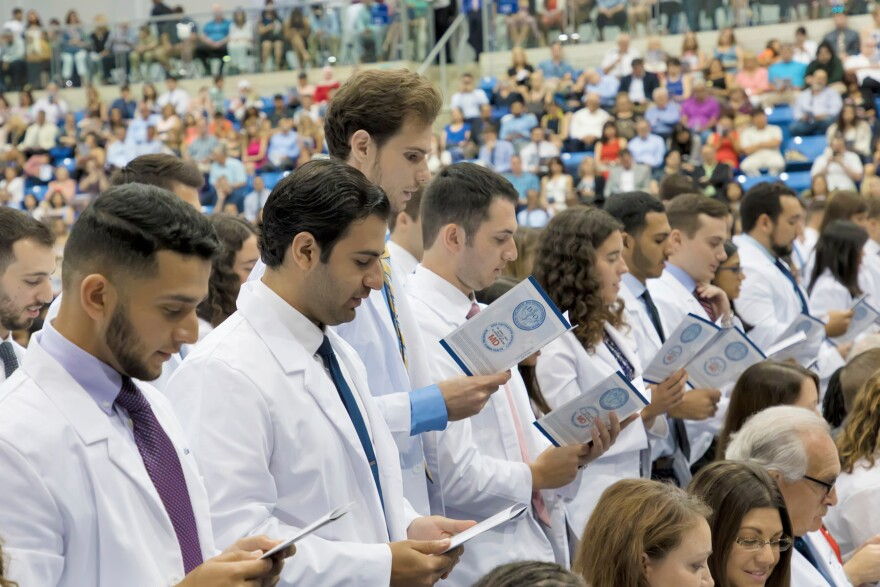 Members of the Dr. Kiran C. Patel College of Allopathic Medicine (NSU M.D.) recite the modern Hippocratic Oath at NSU's joint White Coat Ceremony.