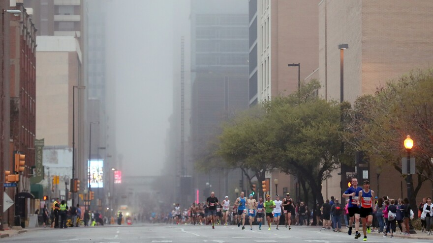 Runners make their way through Dallas during a half marathon in 2018. Texas has experienced massive population growth in the past decade, but officials there have decided not to spend any money or make statewide plans for the 2020 census.