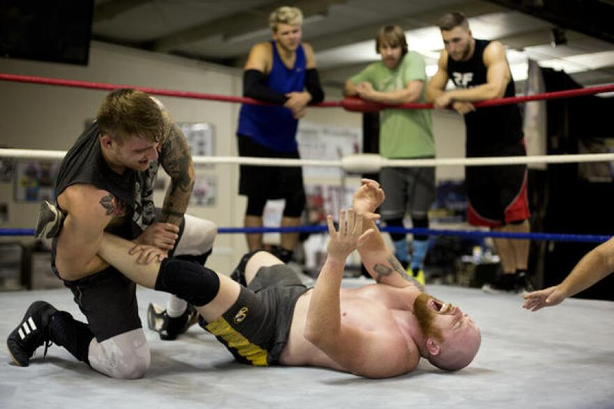 Sean Phillips and Leland Race wrestle at the Harley Race Wrestling Academy.