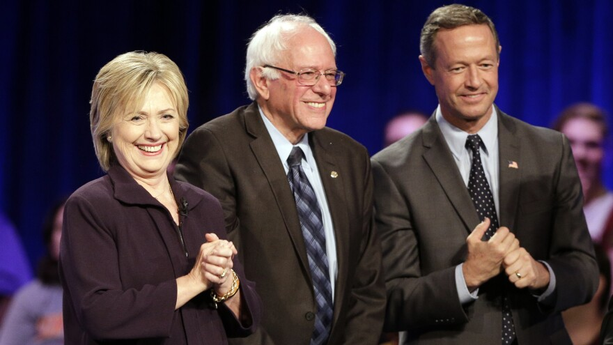 Hillary Clinton, Bernie Sanders and Martin O'Malley take the stage after individually answering questions during Friday night's First In The South Democratic Presidential Forum at Winthrop University in Rock Hill, S.C.