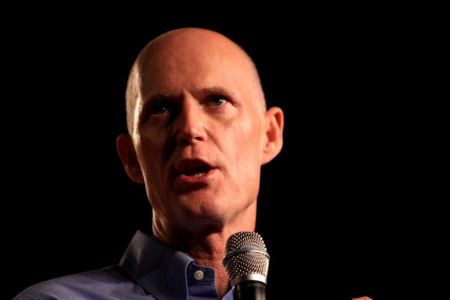 Florida Gov. Rick Scott will be visiting California soon. A controversial job-recruitment radio spot has preceded him.