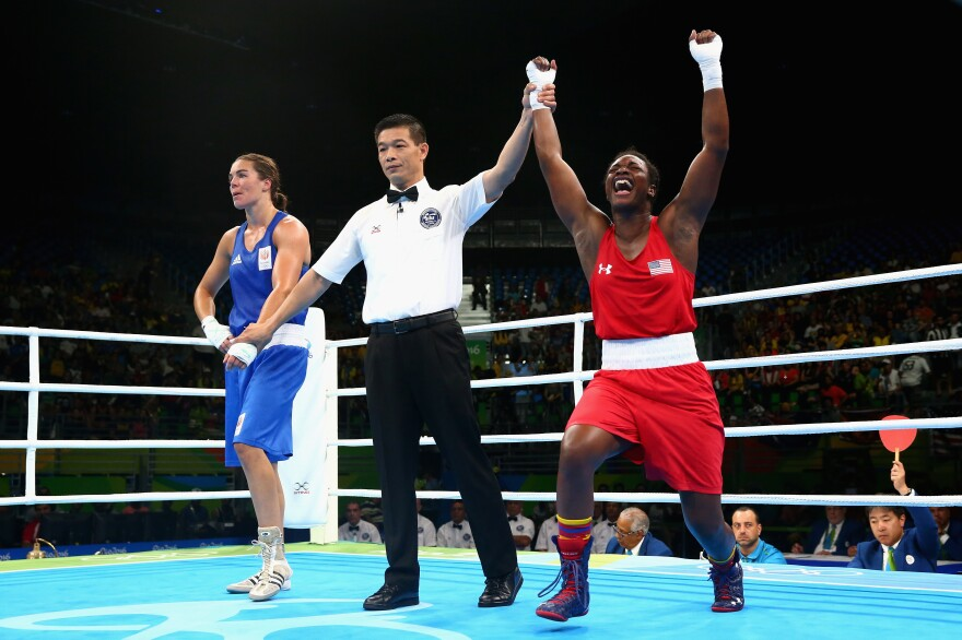 Claressa Shields of the United States (right) celebrates victory over Nouchka Fontijn of the Netherlands on Sunday.