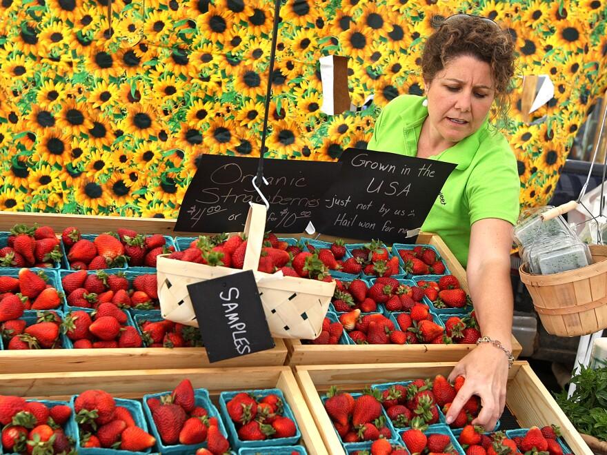 Lisa Steketee restocks strawberries during the Laramie Farmers Market in Wyoming, in 2009.