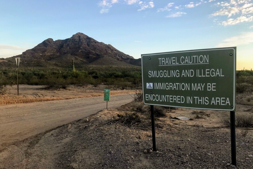 "A sign outside Ajo, Ariz., warns hikers to keep an eye out for people who have unlawfully crossed the nearby border with Mexico. No More Deaths and other humanitarian groups use a private residence they call ""the barn"" on the outskirts of the small town as a base of operations."