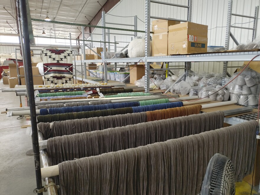 The dyed woolen yarn is hung on poles to dry.