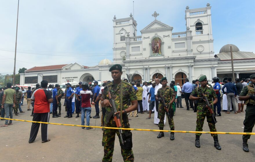 Sri Lankan security personnel keep watch outside St. Anthony's Shrine following the blast at the church.