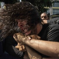 Plainclothes police detain an anti-government protester during a protest in Havana, Cuba, on Sunday. Hundreds of demonstrators went out to the streets in several cities in Cuba to protest against ongoing food shortages and high prices of foodstuffs.